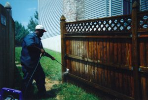 Residential power washing of a fence